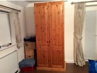 Pine Wardrobe with slide out metal drawer and shelf. Lots of storage space.