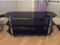 Black glass tv stand like new for large tv