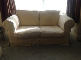 Two seater sofa, with removable covers that can we washed in machine.
