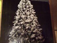 Snow covered artificial Xmas tree