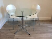 Round glass dining table and 2 matching chairs