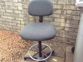 Swivel high chair suitable for architects drawing board