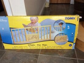 Child's bedrail light wood