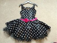 GORGEOUS BLACK, WHITE AND CERISE PINK STARS ROCK AND ROLL/JIVE DRESS AGE 7 to 9 YEARS