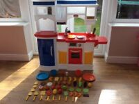 Little tikes play kitchen - excellent condition! Comes with over 50 pieces of new play food!
