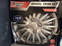 13 inch wheeltrims. ( new)