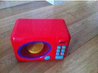 Early Learning Till and Marks & Spencer's microwave toy oven - sold as a set.