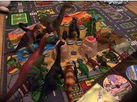 18 Dinosaurs, plastic playmat, volcanoes, rocks and 4 DVDs