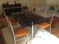Retro Smoked Glass Dining Table & 4 orange vinyl/Chrome chairs