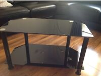 TV stand. Black and chrome, glass