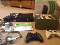 Xbox 360 with control pads and docking station with lots of games