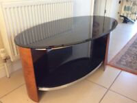 oval coffee table 4ftx2ft black glass and wood surround in Immaculate condition