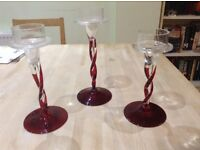 Three Glass Maroon and Clear Candlesticks