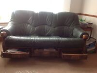 Solid oak based 3 seater leather settee and pouffe.