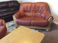 2 seater terracotta leather and oak sofa and chair with solid wood coffee table