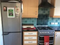 Fitted Kitchen including worktops, hood, duel fuel cooker and fridge freezer