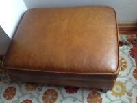 Beautiful brown leather ottoman with decorative nails