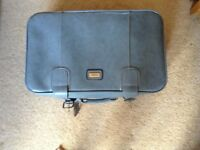 """Sky blue vinyl hand suitcase, used once. Size 24"""" x 16"""" x 7 and 1/2"""