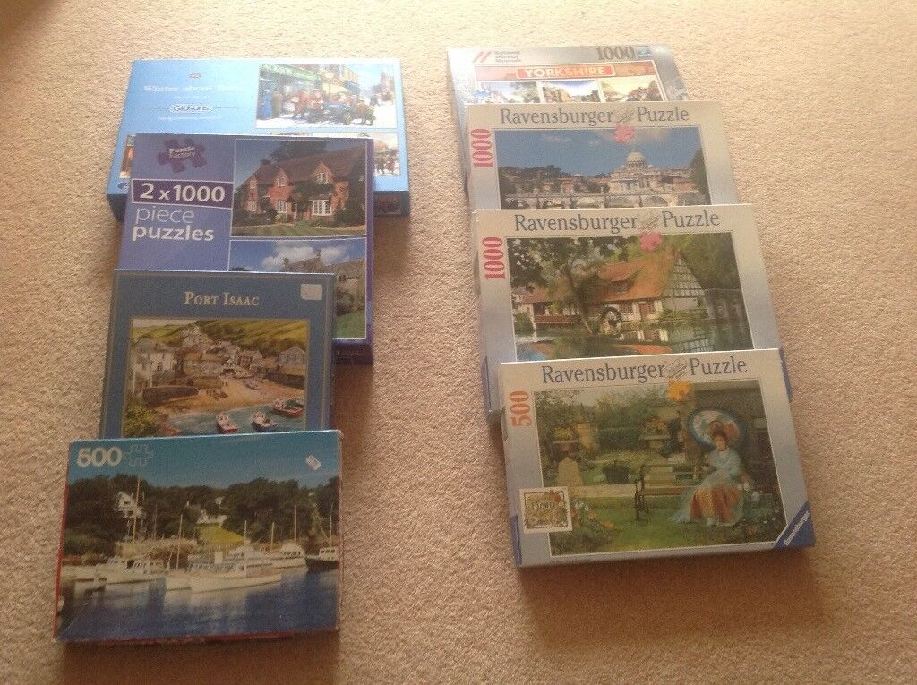 EIGHT BOXES OF JIGSAW PUZZLES, 1000 and 500 hundred pieces.