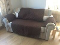 Reversible animal cover for two seater sofa