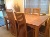Oak table and six high back chairs good quality