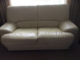 Cream leather two seater and chair. Great condition.