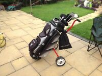 Set of golf clubs ...plus golf bag ...plus golf trolley ..balls.. tees ..shoes ..gloves the lot £60