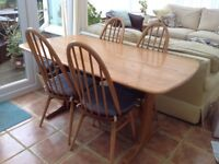 Ercol refectory dining table and 4 Windsor dining chairs in light wood finish