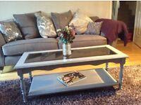 Grey solid wood coffee table.