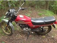 125cc bike. Cheap and cheerful, passed and valid MOT for a year.