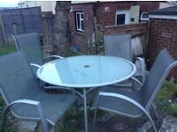 Excellent condition glass topped table and chairs