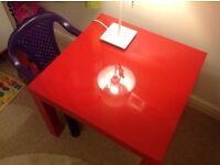 Red table IKEA and purple kids chair