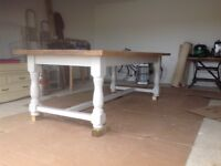 Stunning old farmhouse table with pine planked top. Legs painted a pale grey.