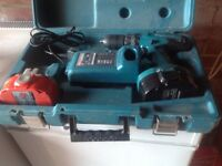 Makita 18 volt combi drill two batteries one brand new charger
