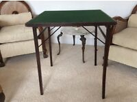 Vintage card table good condition has other uses don't miss this bargain. Is