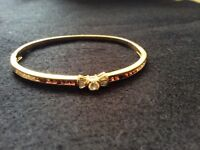 Diamond and garnet encrusted 18ct bangle