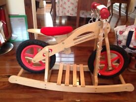 Brand new child's wooden balance bike with stand