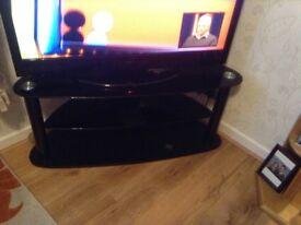 Black glass t v stand in excellent condition