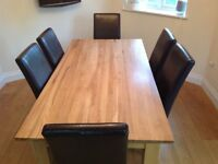 SOLID OAK DINING TABLE AND FOUR BROWN FAUX LEATHER HIGH BACK CHAIRS X 4 APPROX 4 YEARS OLD