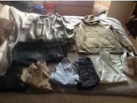 Bundle of men's clothes and pair of trainers