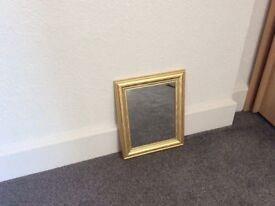 Brushed gold effect mirror
