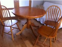 Round pine dining table and three chairs. Good condition. £75.00
