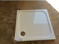 Shower tray size 76x76 bought from village bathroom in error. Shadow of sun on tray.