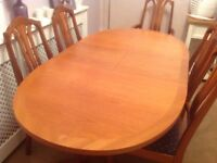 Solid teak oval Extendable dining table plus 6 chairs