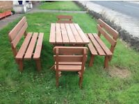 Wooden garden table with benches and chairs