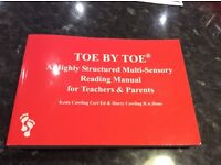 TOE BY TOE. A Highly Structured Multi- Sensory Reading Manual for Teachers and Parents