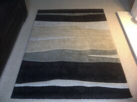 Large Rug in lovely shades of browns beige cream and grey