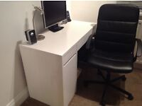 White computer desk and black office chair