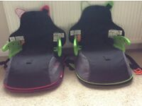 Trunki BoostApack x 2. Pink and Green. 2 in 1 Car booster seat and Backpack