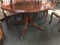 Reduced round pedest dining table